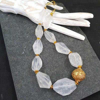 Crystal quartz with goldwash bead